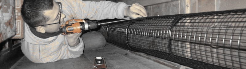 Aiano engineer installs bespoke pipe guards at All Saints Church, Wickham St Paul