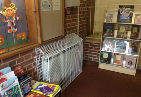 SH24 sloping top storage heater guard at Coldharbour Library