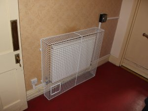 AIANO radiator guard with control flap and skirting cut outs