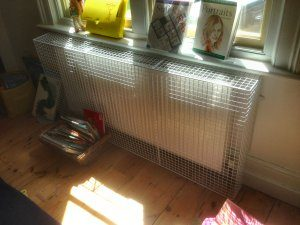 An AIANO wire mesh heater guard installed in the nursery