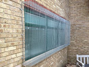 AIANO bespoke galvanised security grilles after installation