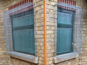 Two of the AIANO bespoke galvanised security grilles after installation