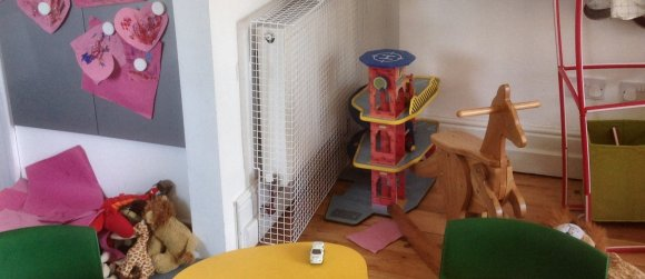 AIANO wire mesh radiator guards for use in a Nursery in East London